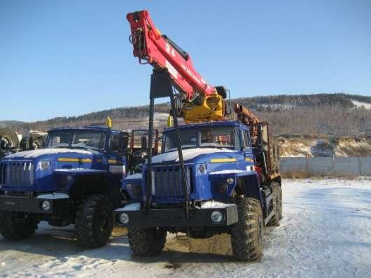 Лесовозный тягач Урал 55571-1151-70, евро 4 с кму Атлант С-100+ прицеп роспуск