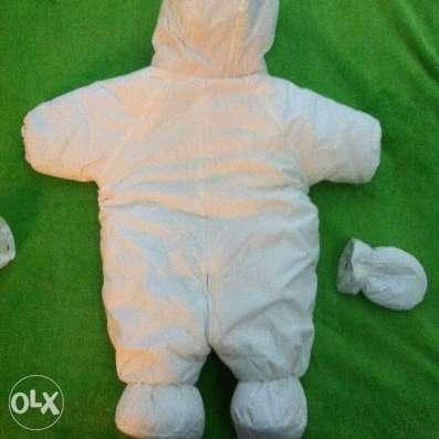 Продам детский комбинезон теплый белого цвета на 3-6 месяцев