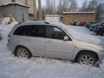 автомобиль Chery Tiggo